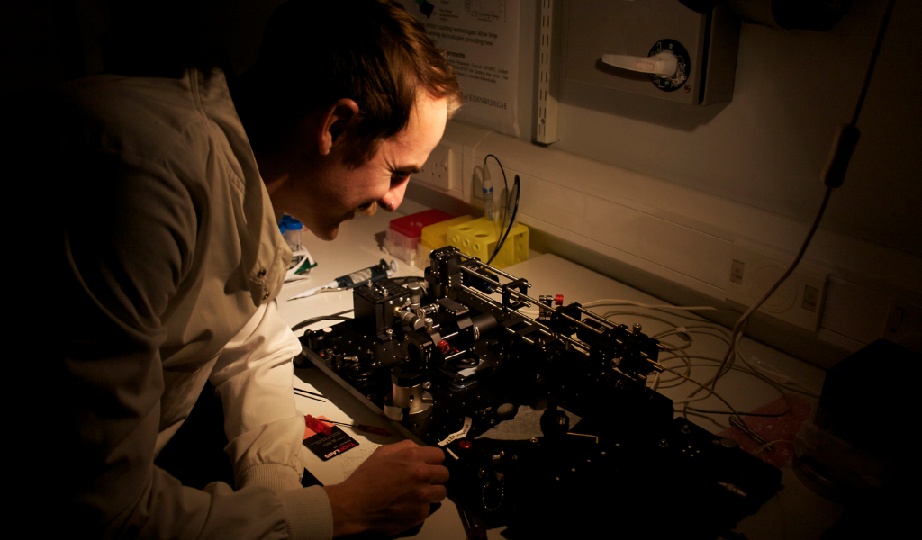 Scientist examining equipment